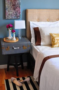 The layers of pattern, fabric are delicious. I adore that wall color and love the mustard yellow as an accent with the denim suitcase. feminine. not matchy matchy and Nick could live with it too.