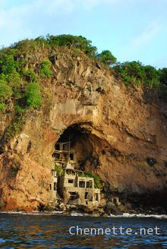 This is a strange house built into the cliff on one of the islands near Bequia. It is abandoned now. The beginning of the rail for the grand staircase is actually a whale rib. Grenadines, in the Carribean