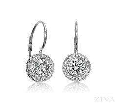 Diamond Stud Earrings in Bezel Setting with Pave Halo and Lever Backs. 1ct tw of center stones (G/SI2 quality) surrounded by 0.30ct of round diamonds (G/SI1 quality). Also available in 2ct, 2-1/2ct an