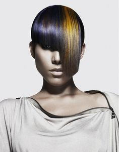 Avant-garde hairstyle with metallic colours and fringe