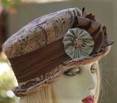 Edwardian, steampunk, Boho riding/bucket hat in quality textured tapestry fabric in Downton Abbey vintage style. A beautiful hat made in a floral pattern with variations of brown with a hint of sage green. Has a dark brown pleated band accented in a olive green Florette and button. Lined in a complementary satin. READY TO SHIP.... Made to fit a medium. A medium head measurement is 22 1/2. I can remake this hat in your size. If you need to purchase this hat in a different size, it will be…