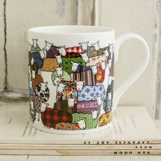 Fine Bone China Mug with illustration of colourful sheep by Mary Kilvert. Height: 8cm. Diameter: 7cm. Dishwasher safe. Shipped in protective packaging.