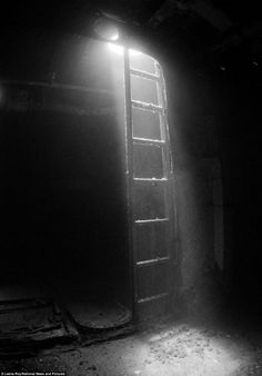 Leena Roy's creepy photograph of a ladder inside a US submarine rescue vessel Kittiwake in Grand Cayman