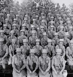 """Members of the Women's Auxiliary Army Corps, commonly known as WAACs, don their first gas masks at Fort Des Moines, Iowa, in June 1942. The female troops were famously praised by General Douglas MacArthur, who called them """"my best soldiers."""""""