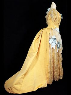 Morin-Blossier silk faille gown with embroidered tulle skirt panel and moiré silk ribbon bows, c.1870-80.