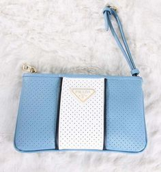 http://forprada.net/images/yt/Prada%20Perforated%20Leather%20Wristlet%20Clutch%20in%20Blue.jpg