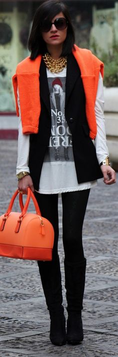 .White oversized tee, black sweater, orange sweater over shoulders, black leggings or jeans and boots