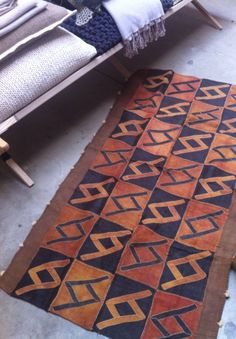 A handwoven mat made of raffia fibers from the Kuba tribe. On sale at ShoowaBaazar https://www.etsy.com/listing/199861290/brown-and-copper-shoowa