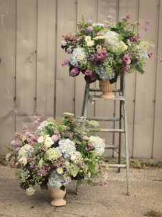 Not these colours but the lovely loose feel to the arrangements for the pedestals