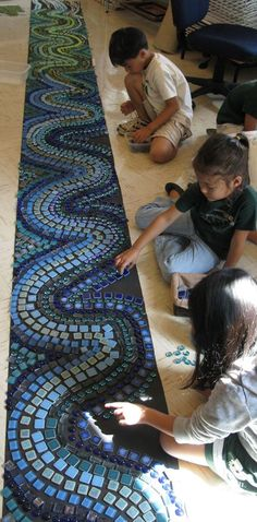 From midpac.edu: tile work with children creating their own designed patterns, color gradation, shapes, etc. building upon each other's ideas.  Great example of using loose materials to support the development of creative thinking.