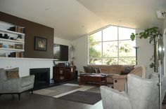 Spacious remodeled living room with large window