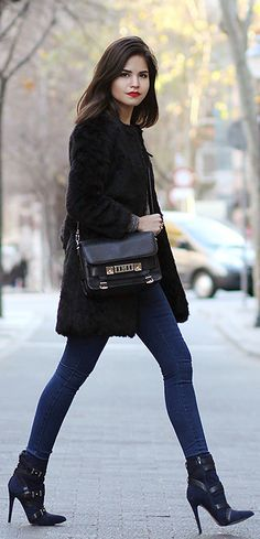 Just The Design: Adriana Gastélum is wearing a black faur fur coat and indigo jeans from Iclothing, boots from Guess and the bag is Proenza Schouler PS11