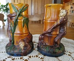 """2 Antique Majolica Monkey Bamboo Candle Stick Holders 9.25"""" T×5.75"""" bottom width, 3.75"""" top width, 1"""" candle insert opening. No crips or breaks. Two monkeys being mischievous (pulling tail, chasing) around base of a jungle bamboo. 
