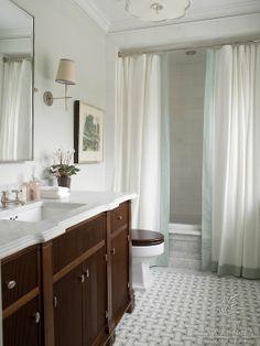 Savannah mosaic bathroom floor in Carrara, Thassos, and Bardiglio. Love the detailing around the tub