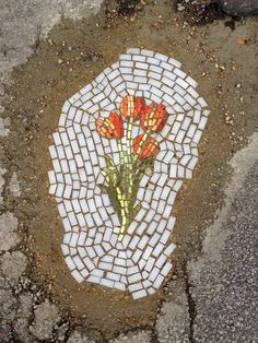 Guerilla Mosaic Artist Now Filling Chicago Potholes with Flowers http://restreet.altervista.org/jim-bachor-ripara-le-buche-delle-strade-con-i-mosaici/