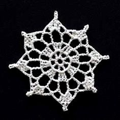 Crochet Snowflake #5. lots of flakes here.