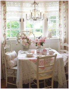 shabby chic - alessandra fiorani - Picasa Web Albums-  I like the lace table cloth layered over the rose patterned table cloth