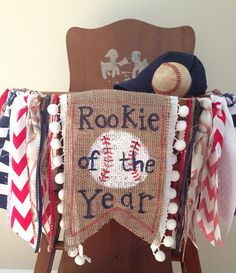 Take me out to the ballgame! Your little slugger is turning one, how fun!! This red, white and blue baseball themed highchair banner is perfect for his birthday party, cake smash photos and first birthday photo shoot! Coordinating baseball, red, white and navy blue fabrics, rick rack