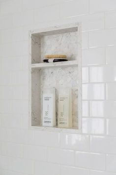 bathroom White subway tiles finish a walk-in shower completed with honed marble-tiled niches. Tile Shower Niche, White Subway Tile Shower, Subway Tile Showers, Bathroom Niche, Master Bathroom Shower, Shower Tile Designs, Marble Showers, Upstairs Bathrooms, Small Bathroom