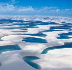 BRAZIL,....What a surreal sight! If you ever travel to Brazil make sure to visit Lençóis Maranhenses National Park, especially between the months of January and May. The rainy season, it's during that time that Brazil's white sand dunes, which are spread across 570-square-miles, transform into an amazing natural phenomenon. Fresh water collects in the valleys between the sand dunes, creating thousands of aqua-colored lagoons