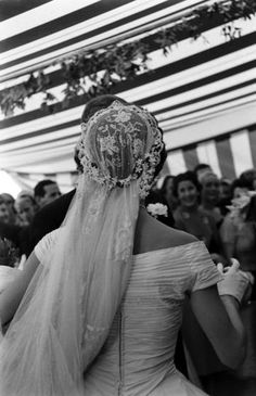 View from behind of Jacqueline Kennedy - (in a Battenburg wedding dress) as she dances with her husband, future US President John F Kennedy - at their wedding reception, Newport, Rhode Island, September Jacqueline Kennedy Onassis, Jackie Kennedy Wedding, Jfk And Jackie Kennedy, Les Kennedy, Jaqueline Kennedy, Jackie O's, Wedding Veils, Wedding Day, Wedding Dresses