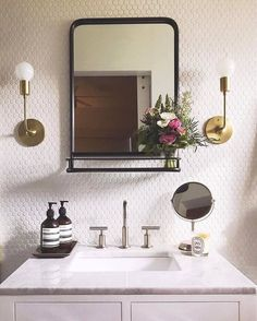 floor to ceiling white hexagon tile in the bathroom