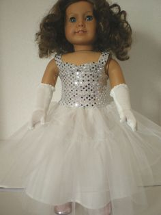 American Girl doll clothes, sequin tulle dress, gloves Silver sequin bodice has sweetheart neckline, wide straps in a fully lined bodice with a double layer tulle skirt over a satin underskirt. Dress has open back with velcro close for a tailored fit, full and lush overskirt White knit gloves above the elbow accent the evening look.  A lovely, dramatic outfit for your Girl. . A lovely prom dress for 18 inch dolls, fitted on American Girl for best fit.  Doll and shoes not included.  View more…