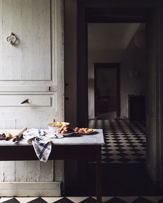 moody kitchen with the most beautiful black and white tiled floor