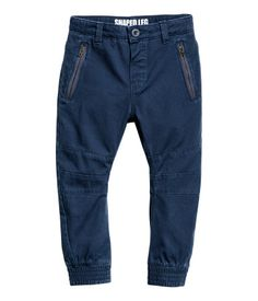Dark blue. Pants in soft, washed cotton twill. Adjustable elasticized waistband, mock fly with button, side pockets with zip, and welt back pockets. Slim,