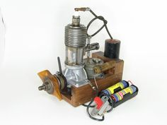 History of Model Engines   Model Aviation Small Engine, New Engine, Airplane News, Rc Motors, Navy Carriers, Rc Radio, Combustion Engine, Spark Plug, Model Airplanes