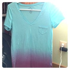 Blue and purple ombré tee shirt Light blue tee shirt that fades into purple with a small pocket. Old Navy size XS, but fits a little bigger, never worn without the tags Old Navy Tops Tees - Short Sleeve