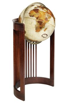 """This globe stand is an adaptation of one of the most universally recognized furniture designs found in the Frank Lloyd Wright Foundation archives. It is a modified version of the famous """"Barrel Chair"""" originally designed by Frank Lloyd Wright in 1903 a Frank Lloyd Wright, Floor Globe, Friedrich Schiller, Map Globe, Globe Art, World Globes, Barrel Chair, Arts And Crafts Movement, Objet D'art"""