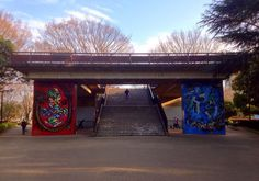 #Shibuya-mon or the Gate of Shibuya is located in #YoyogiPark. You can often find groups of dancers practicing under the gates or filming videos in front of the #cool #reddragon and #bluetiger paintings   #streetart #urbanart #stairway #walkinthepark #cherryblossomseason #sakuraseason #itsfinallyhere #Yoyogi #渋谷門 #代々木 #代々木公園 #渋谷 by japantourguide