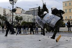 Riot police chase a youth during clashes outside the parliament on December 6, 2011, as about 1,000 school pupils marched to commemorate the police killing of a student three years ago which sparked violent riots lasting weeks. Pupils and students marched to mark the December 6, 2008 death of Alexis Grigoropoulos, 15, shot by police as Greece first came under pressure from the eurozone debt crisis. AFP PHOTO / ARIS MESSINIS