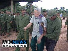years after the genocide in 1975 Cambodia,pol pot is being walked to his trial.