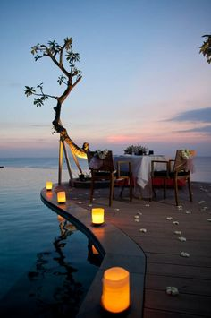 cliffside dining for a little romance  LED battery operated flameless pillars for the WIN. Oh the bliss of this photo!!