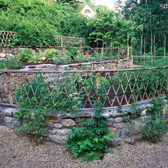 A stone wall with lattice fencing makes a beautiful, casual enclosure for either a cutting garden or vegetable garden. Stone Wall, Backyard Fences, Hardscape, Fence Design, Garden Wall, Building A Retaining Wall, Fence, Garden Vines, Fence Landscaping