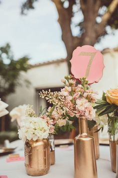 painted gold bottle centerpieces / http://www.deerpearlflowers.com/bronze-copper-wedding-color-ideas/