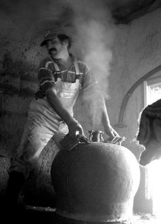 Crete and a man making raki!