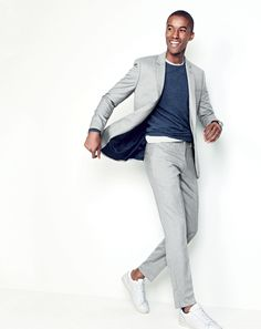 J.Crew men's Ludlow suit jacket, lightweight Italian cashmere crewneck sweater, garment-dyed T-shirt, Ludlow suit pant and New Balance® 791 leather sneakers.