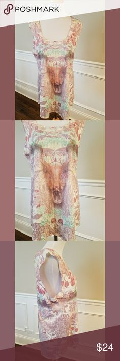 """Chaser Bull Head Long Tunic Muscle Tee SZ S Beautiful floral print long tunic sleeveless muscle tee from Chaser with Bull Head print on front and back. Sleeveless with scoop neckline. 50% cotton/50% polyester. Super soft. Size small but Chaser tends to run large. 29"""" long and 19"""" across bust. Perfect condition with the exception of some teeny tiny holes on the bottom front. Due to the colors and pattern, they are almost impossible to see and look like they are part of the distressed style of…"""