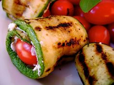 Grilled zucchini roll ups. Lucy tried zucchini fries today at carabas and loved them! This is a neat way to have zucchini for lunch.