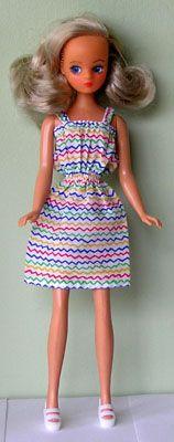 Rainbow dress for daisy doll