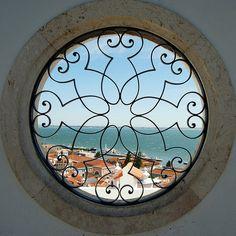 Window by Alessandra Kocman, via Flickr -- Miradouro de Santa Luzia, Rua do Limoeiro, Alfama, Lisbon, Portugal