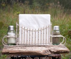 This caddy holds standard size napkins and includes green glass Mason jar salt and pepper shakers. Overall caddy measures x x Green glass Mason jar salt and pepper shakers are included. Napkins, salt and pepper are not included. Rustic Gardens, White Gardens, Antique Farmhouse, Farmhouse Chic, Kitchen Caddy, Kitchen Redo, Salt And Pepper Restaurant, Metal Candle Holders, Garden Gates