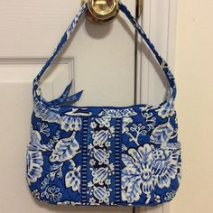 Vera Bradley bag NWOT Small Vera Bradley bag. New without tags. Beautiful blue and white flower pattern.four small pockets on the inside. Two small pockets on the outside. Zipper works. Clean. This is a small size purse. Vera Bradley Bags