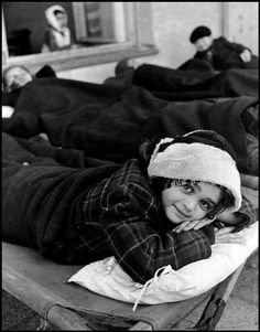 1948 : Orphans suffering from Tuberculosis rest on the terrace of the Zofiowka Sanatorium, Otwock, Poland. Photographer : David Seymour