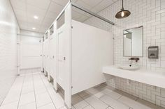 Ironwood Manufacturing laminate toilet partitions and captured panel bathroom doors. Clean, upscale  public restroom stalls.