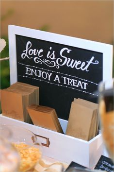 love is sweet enjoy a treat dessert table sign #desserttable #diy #weddingchicks http://www.weddingchicks.com/2014/03/26/peach-wedding-in-colorado-wine-country/