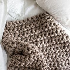 """This kit includes everything you need to make this gorgeous chunky crochet blanket featured in this photograph. The finished blanket measures 36"""" x 42"""". It includes :: 8 skeins of gorgeous Cascade Mag"""
